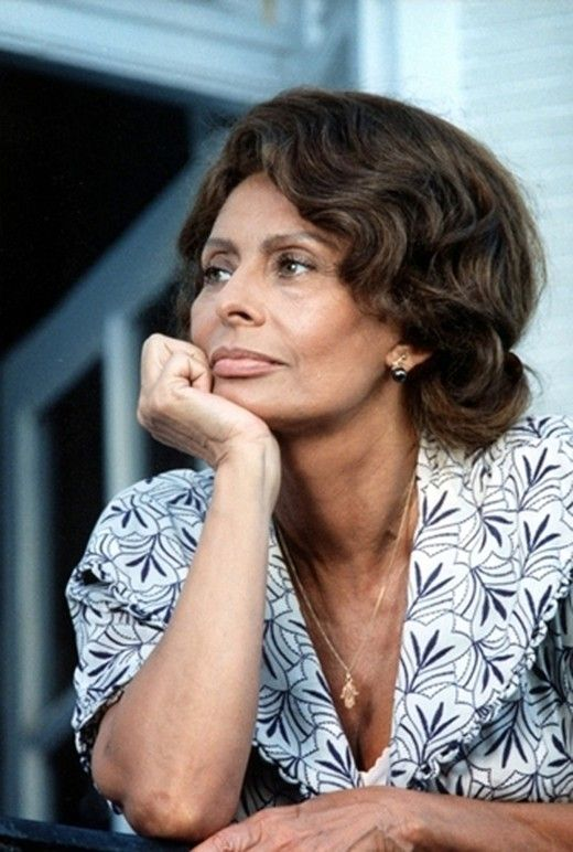 """At 79 years of age, Sophia Loren is as glamorous, attractive and vivacious as she was in 1966, dressed in a red PVC coat as secret agent in Marie Menken's Arabesque. With her silk scarves, pearl earrings, and deep chestnut skin, she is the epitome of Italian glamour. """"There is a fountain of youth,"""" she once said, """"that when you learn to tap it, defeats age."""
