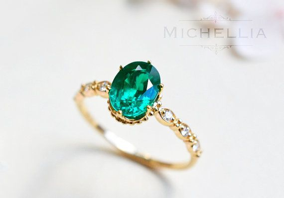 Emerald engagement ring with gold accented diamond band | Michellia Designs /Etsy