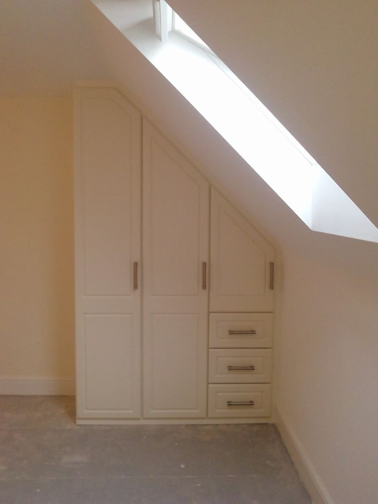 A small wardrobe in a loft conversion showing angled doors.  www.harmonymadetomeasure.co.uk