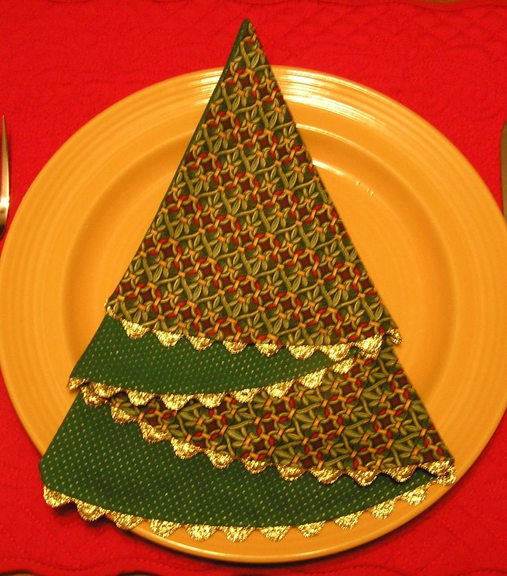"Christmas Tree Napkin - use a compass to draw an 18"" circle, cut in half.  Use the half for pattern, cut 1 from 2 different fabrics, sew together leaving a 3 to 4"" hole for turning.  Ric Rac on curved edge.  Would make cute cards from paper 1/2 circles too..."