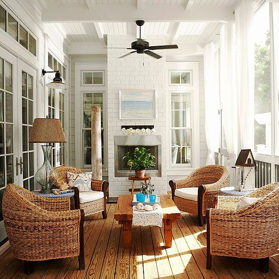 Beautiful covered deck with natural wood floor & white painted ceiling & walls with french doors for an indoor outdoor feel