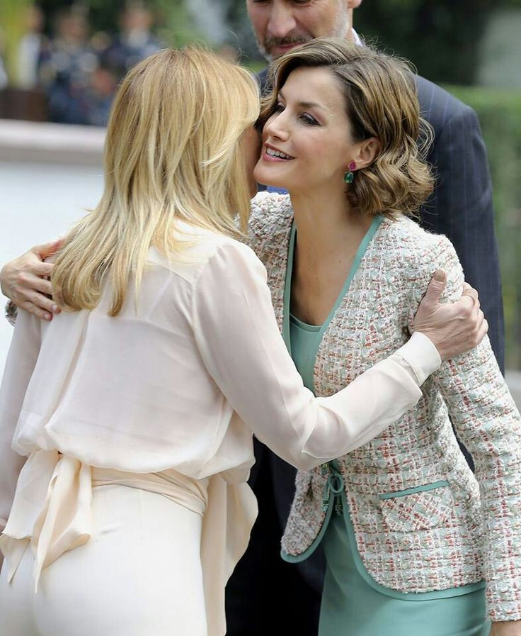 Spanish Queen Letizia and Mexico's first lady Angelica Rivera, greet each other during a welcoming ceremony at the Campo Marte military field in Mexico City on June 29, 2015.
