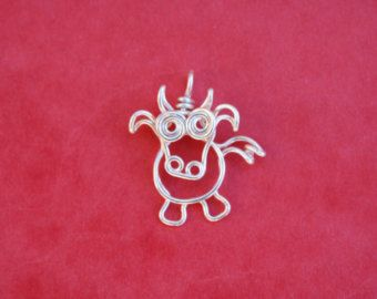 Scorpion, for people born under the star sign of scorpio.      Scorpion is made from a single length of 1mm diameter silver plated copper wire and is delivered with an adjustable cotton wax cord, presented on an embossed white card. Scorpion measures about 2 x 2cm (5/8 x 5/8)    *all my wire jewelry is individually handmade and may vary slightly from the photograph*  *the silver plated copper wire I use is stiff and holds its shape well, however the silver plating may wear over time and…