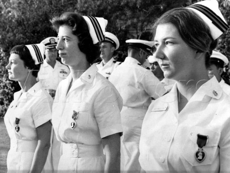 Three U.S. Navy nurses are decorated with purple heart medals in Saigon to become the first American women to receive the medal for service in the Vietnam War at a ceremony on Jan. 7, 1965. The nurses were wounded in an explosion in Hotel Brink in Saigon,