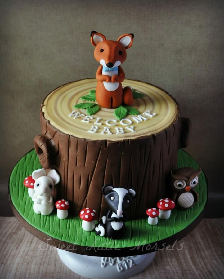 A woodland baby shower theme cake. The animals are made out of fondant. I used modeling chocolate to make the cake look like a tree stump.
