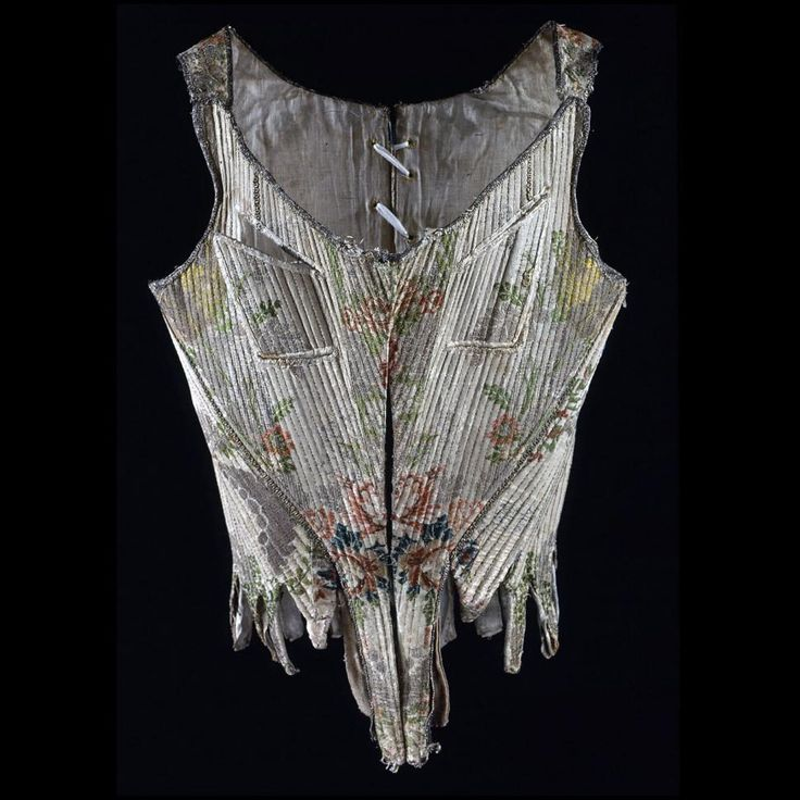 """Stays, altered for nursing (at Colonial Williamsburg) ca. 1765 (textile); prob. altered 1775-1790, Europe, France or Italy Waist: 22""""; Length at center front: 14 3/4"""", bust approx. 30"""". Silk brocaded with silk and metal threads; whalebone; linen, leather linings. Museum Purchase Acc. No. 1986-111"""