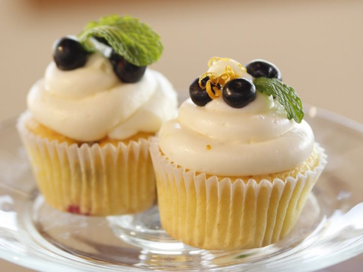 Missy's Lemon and Blueberry Cupcakes from Pioneer Woman on FoodNetwork.com - Again, please read reviews for adjustments.  I'd probably make cupcakes using lemon cake mix with blue berries and use this frosting.