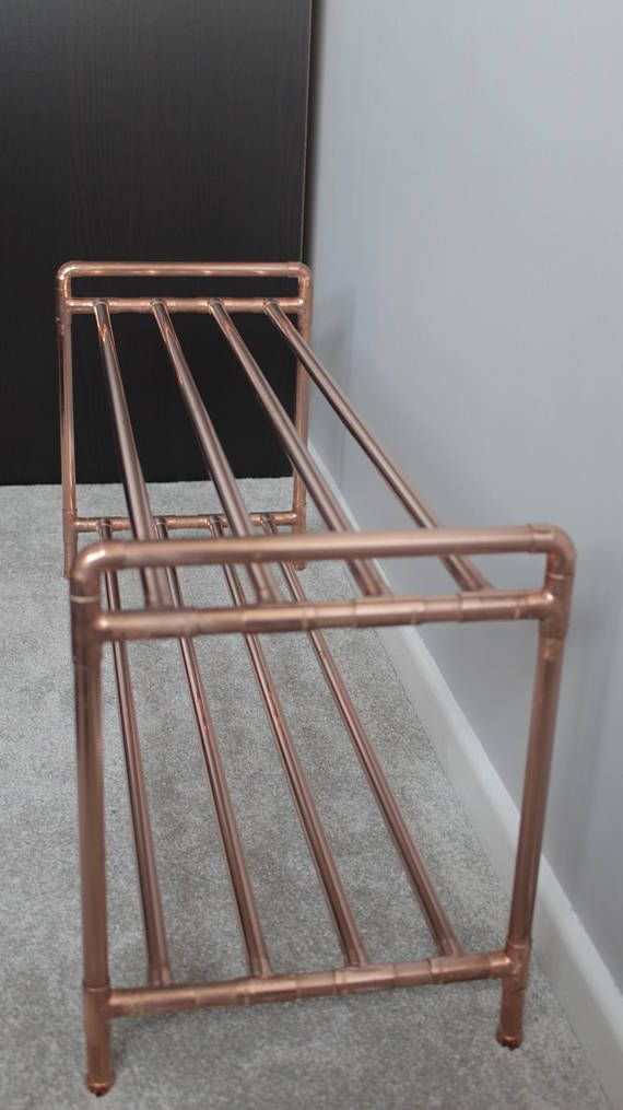2 tier copper pipe shoe rack made from industrial pipe fittings! Perfect for your hallway, utility room or bedroom! Handmade in North East England, this copper pipe shoe rack will add a modern touch to your home while allowing you to store your shoes in style. It boasts two tiers to