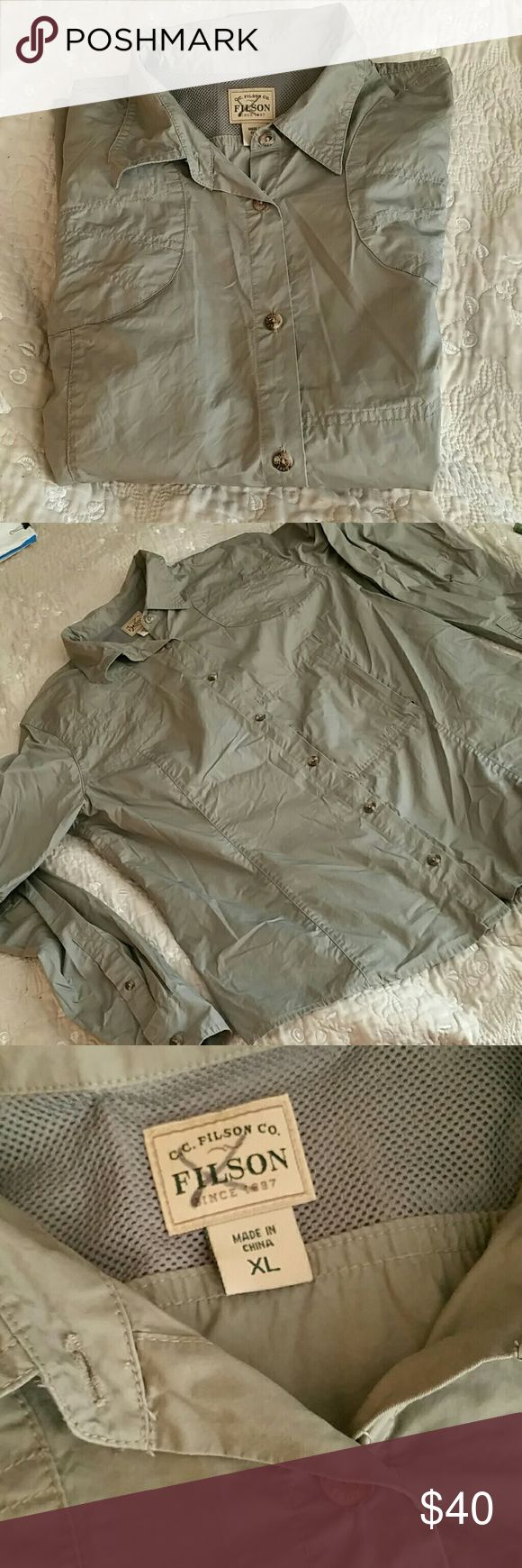 Filson's Khaki Safari Shirt NWOT. Khaki safari shirt from CC Filson's N Co. Vented neckline & unique yoke stitching with single invisible breast pocket.  A steal at this price. CC Filson's N Co. Tops Button Down Shirts