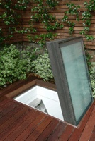 Walk-on, self cleaning glazed access hatch.  http://www.surespancovers.com/glazed.htm