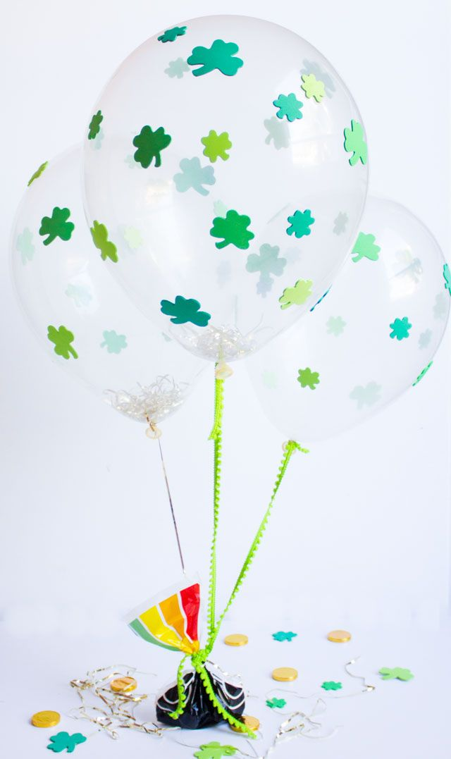 These DIY shamrock balloons are as simple as peel and stick! Make a bunch for your St. Patrick's Day party decor or table centerpiece