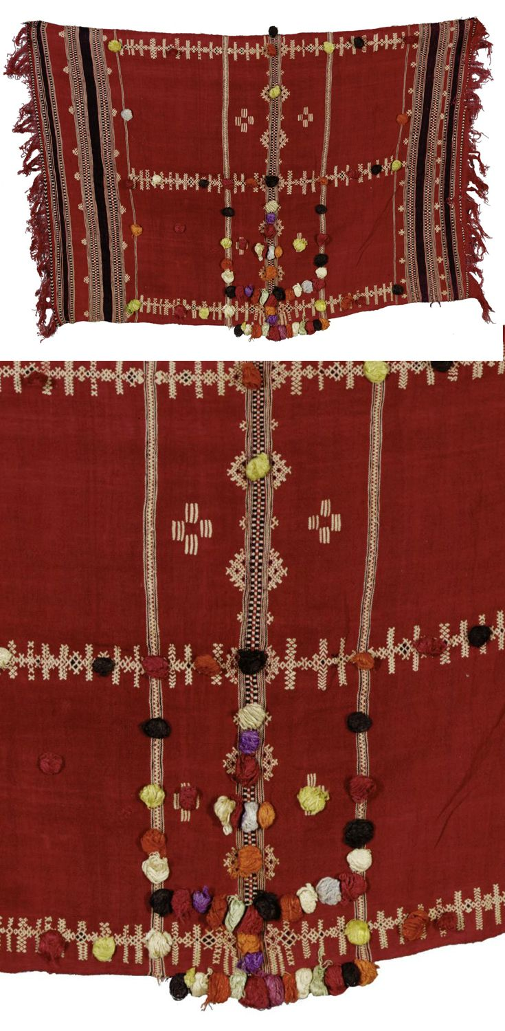 Africa | Moroccan head and shoulder covering (veil) with multicoloured bobbles, a woven geometrical decoration and a black striped border on a red background, with fringes to both ends. | Wool and silk