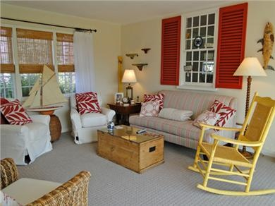 love the red accent colors in this cape cod living room
