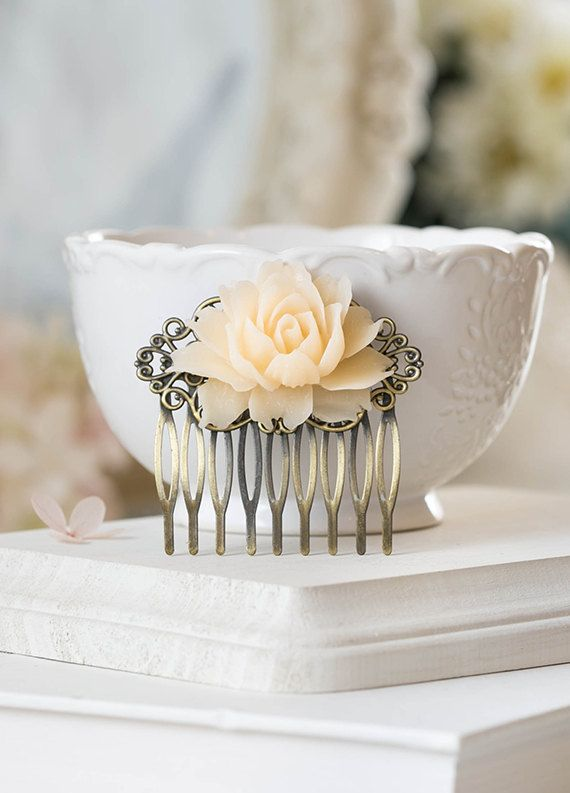 Hey, I found this really awesome Etsy listing at https://www.etsy.com/listing/175616430/ivory-rose-hair-comb-antiqued-brass