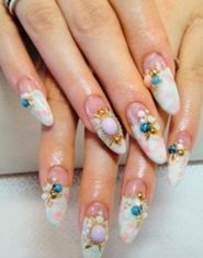 white and pink and blue pastel french tips with stick on diamantes and beads japanese nail art