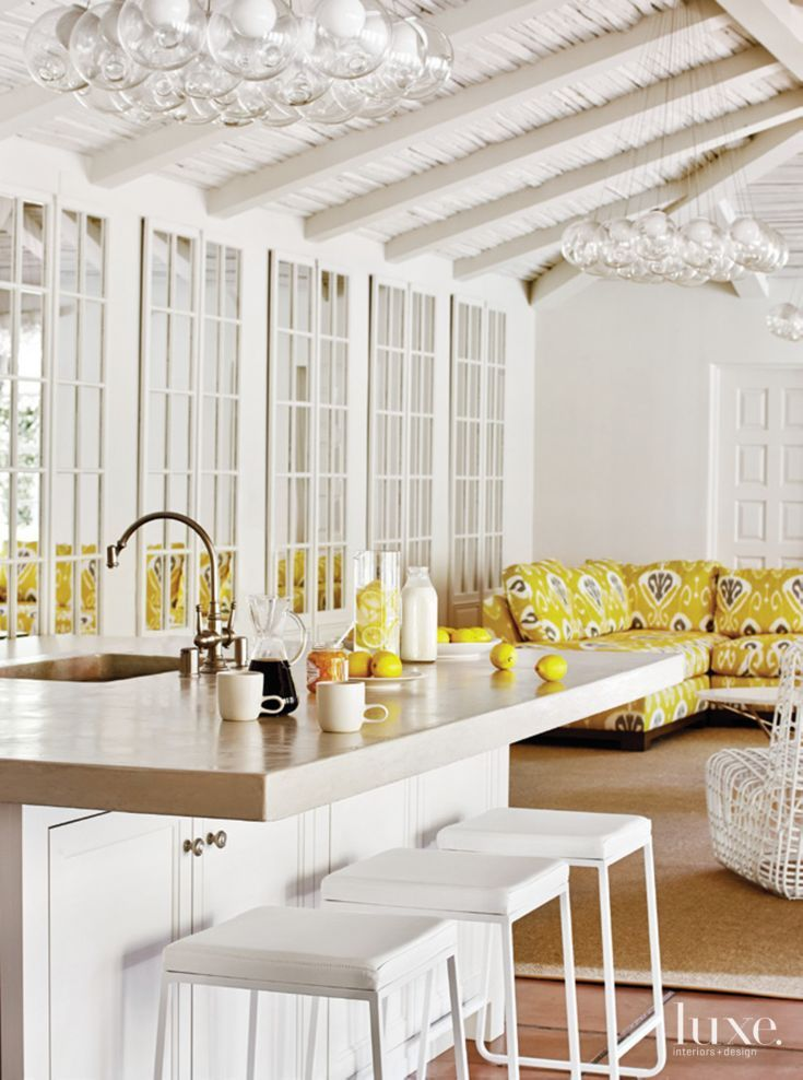 Contemporary white poolhouse kitchen i love the wall of mirrors it really brightens up the space