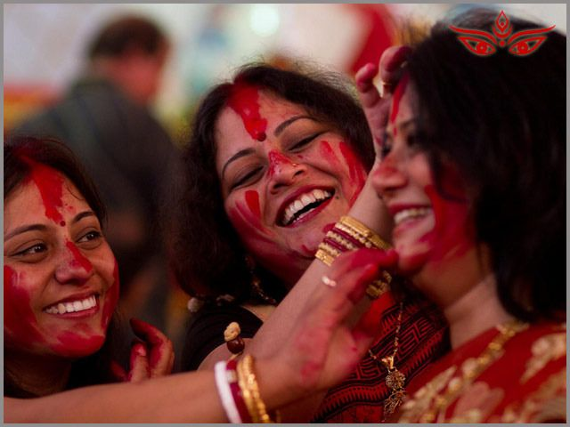 On the last day of Durga puja, Women apply vermilion/sindoor on eachother overcoming the sadness of farewell