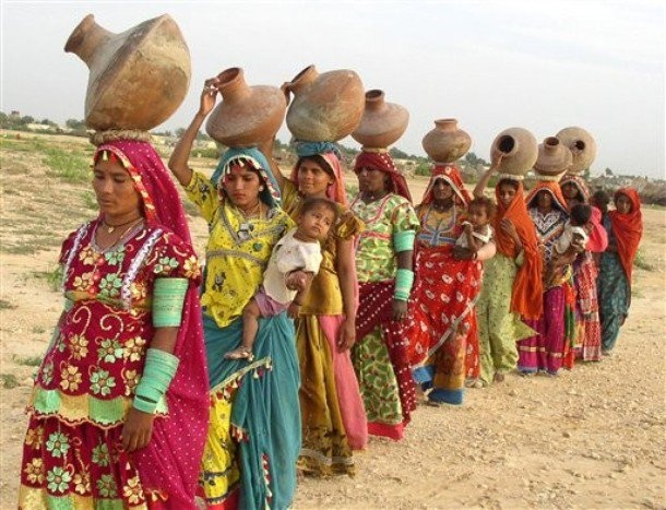 villager women are going to fetch water in a queue.