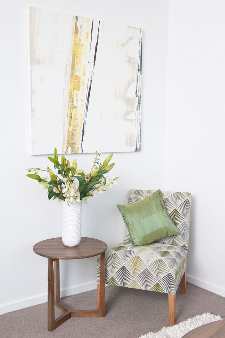 Emme Designs custom upholstered occasional chair in a green patterned fabric.