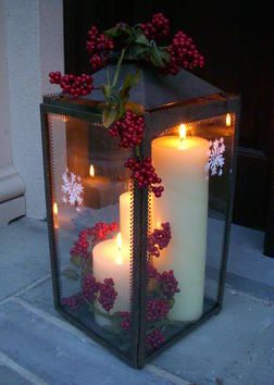 Beautiful Lantern with Christmas decor. Could also be done with l.e.d. candles.