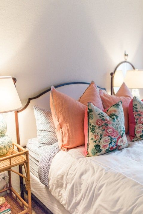 Home Tour - The Guest Bedroom - I love the pink pillows and floral pillows on the white duvet