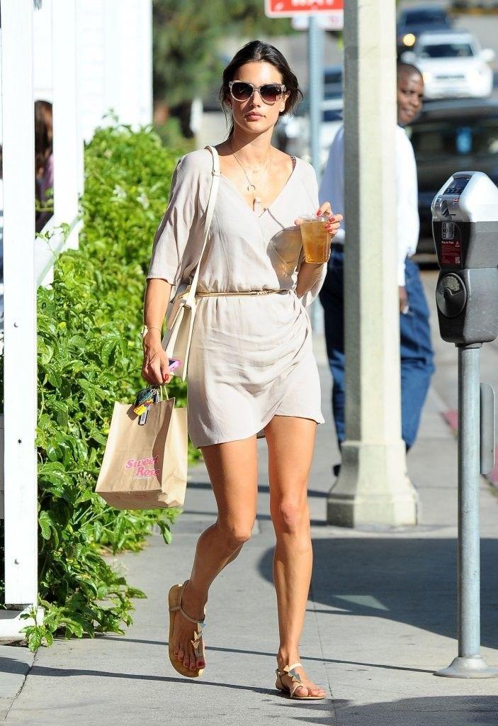 Alessandra Ambrosio wearing Giuseppe Zanotti Triangle-Stud Flat Thong Sandal  ale by Alessandra Windblown Wrap