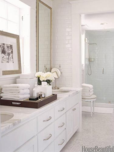 source: house beautiful. Designer David Jimenez wanted this Kansas City home's bathroom to feel like a spa. Counters and floor tiles are Calacatta Gold marble.