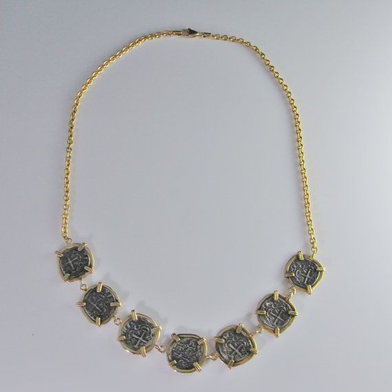 A fine necklace hand made in 14K gold set with coins from the Spanish treasure ship the Atocha. This fascinating necklace was made in the late 1980s. In July of 1986 the Atocha wreck was found including her load of treasure. The Atocha struck a reef and sank on September 6, 1622, during a