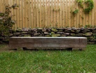 neat rough hewn wood / like the bench & lawn.  good example of vertical fencing (though i like the space between the boards.)