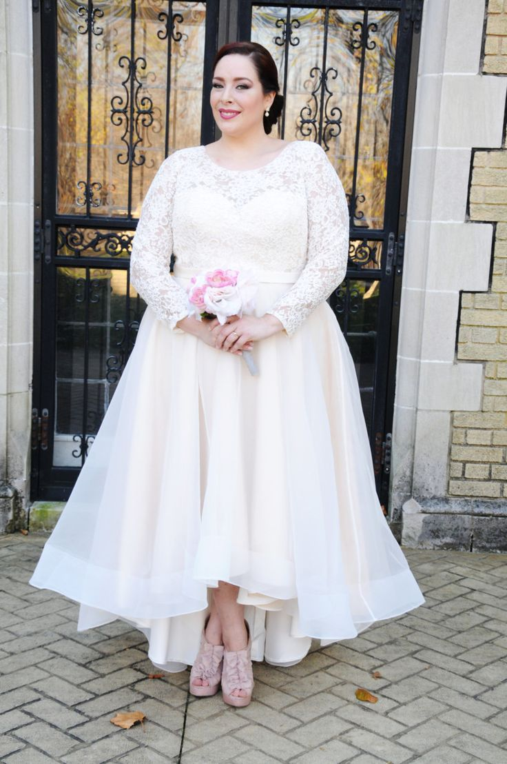 A statement highlow short wedding dress with lace long
