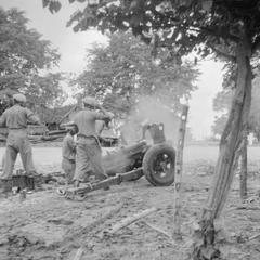THE BRITISH OCCUPATION OF JAVA. A 3.7 inch gun of the 24th Indian Mountain Battery (5th Indian Division) opens fire on an Indonesian mortar position that had been firing onto British positions around the town of Grissee, some ten miles out of Surabaya.