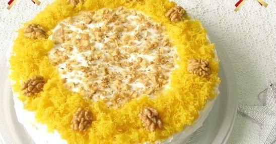 Que tal comemorar com um bolo que tem nozes na massa (que é macia), recheado com baba de moça e coberto com marshmallow? A receita...