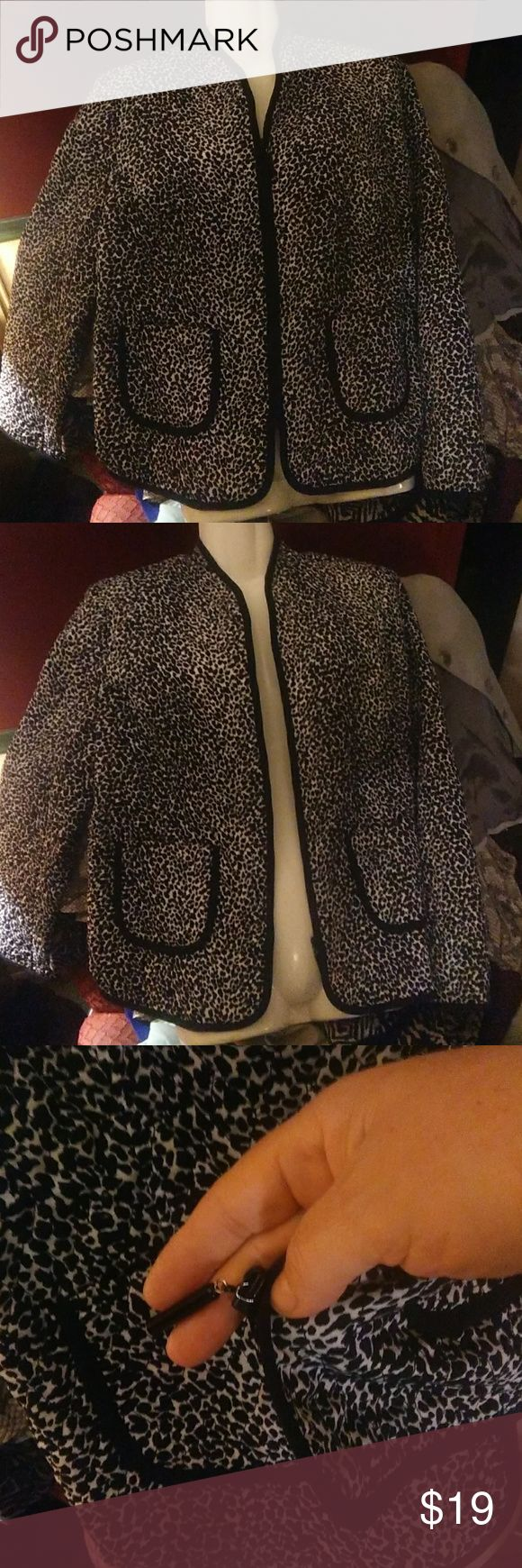 WOMEN'S ZIPPING UP LINED JACKET EUC Gorgeous black and white animal print zip up lined jacket ....this has a quilted stitched to it ..has 2 pockets in front  polyester Requirements Jackets & Coats