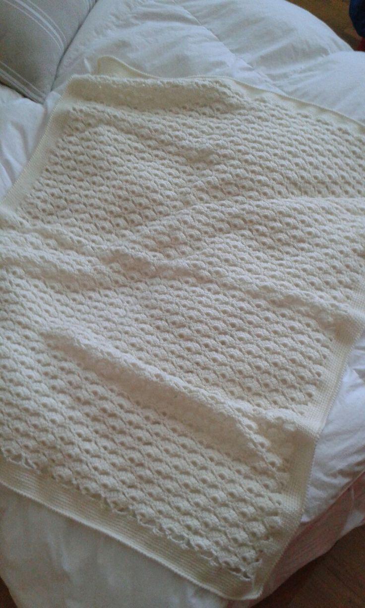 Copertina in lana, lavorazione a uncinetto.