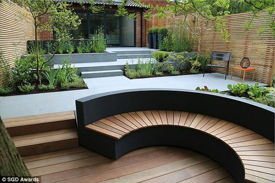 Love this curved decked seat #curves #deckingseat #garden #gardendesign #moderngarden #leighonsea #earthdesigns