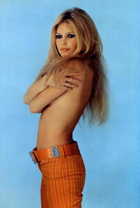 something here... hair, makeup, pose. Maybe with jeans... -Brigette Bardot