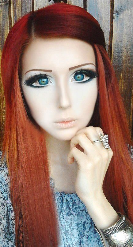 Anastasiya Shpagina, Russian living doll. That's some freakish eye make-up, sister! (Chick looks like this every day ... on purpose!)