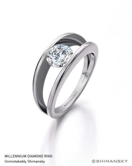 The two bands of the Shimansky Millennium ring represent the coming together of two lives, joined by a diamond in the middle that becomes a symbol of forever.