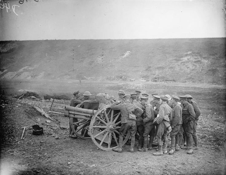 Battles Somme 1st July - 18th November 1916 (Q 4016) Battle of Bazentin Ridge. Gunners examining a 77mm German gun, captured on the 14th July 1916 by the 2nd Royal Irish Regiment: Mametz Wood. Road leading to Death Valley and Bazentin-le-Petit.