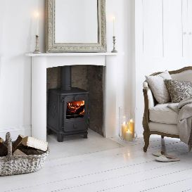 Decore around wood stove; incorporated into the existing fireplace