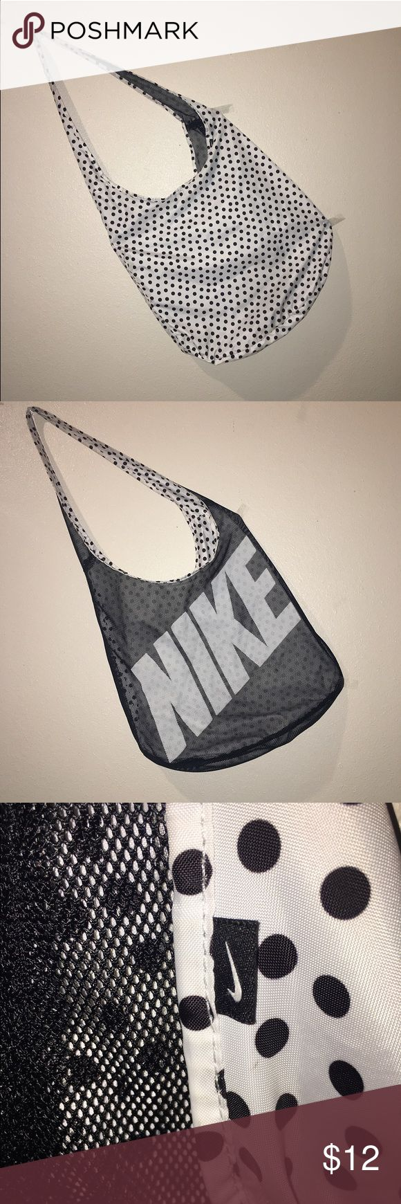 Nike Polkadot and Mesh Reversible Tote This is nearly new reversible Nike tote is perfect from hitting the gym to using as a book bag. It's black and white coloring make it the perfect accessory for any colored top. Make this the most versatile item in your new closet! Nike Bags Totes