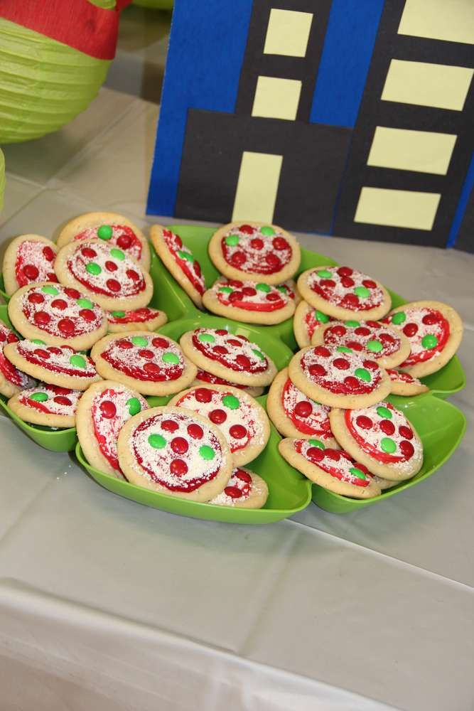 Tmnt turtle pizza cookies! Sugar cookies, red frosting, grated white chocolate and m&ms