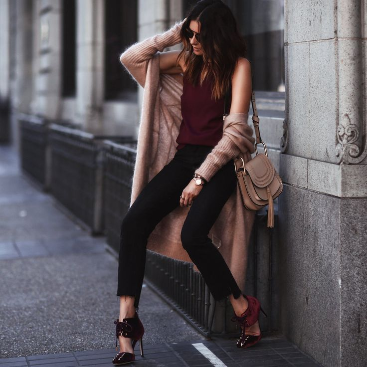 Watch: Movado Cardigan: Acne Studios Top: Amanda Uprichard Jeans: Frame Denim Shoes: Jimmy Choo Bag: Chloe Bracelets: Vita Fede Rings: Vita Fede, Geoffrey Scott, Mejuri Sunglasses: Dior