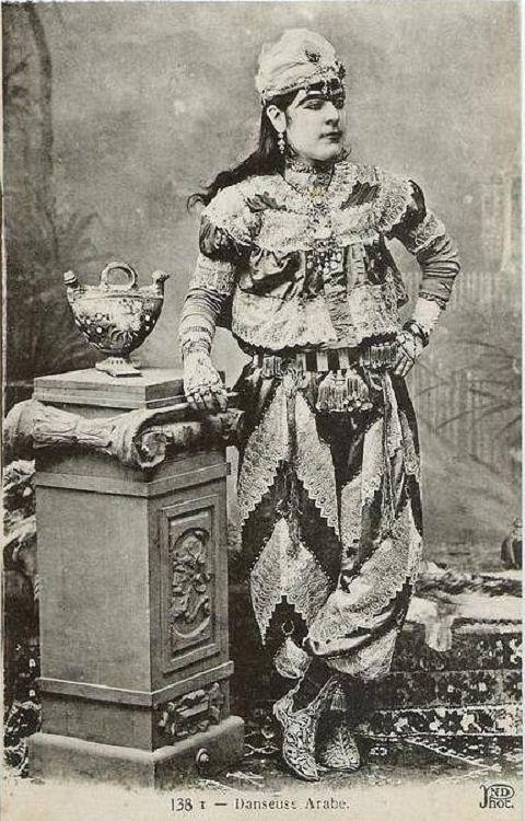Postcard photograph of a 'köçek' (male dancer) posing in costume. Istanbul, late 19th-century.