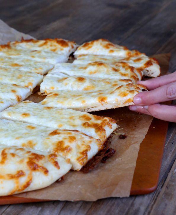 Garlic Gluten Free Pizza Bread Sticks recipe. Simple, glorious cheesy breadsticks made with easy gluten free pizza dough.