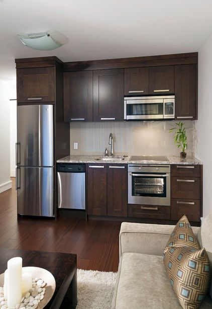 Space-saving kitchen. Less than 9 feet wide, this kitchenette packs lots of options for cooking and food storage into a very practical footprint. It includes a counter-depth 24-inch refrigerator, a sink, an oven with induction cooktop, a microwave and a mini dishwasher.