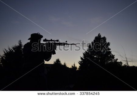 Sniper silhouette forest - stock photo