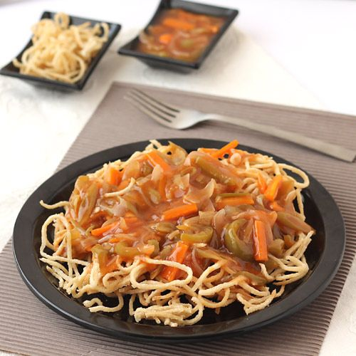 American Chopsuey, a delicious savory dish prepared with crispy noodles and saucy stir-fried vegetables, is an Indian adaptation of popular American dish. This step by step photo recipe is for preparing the Indian vegetarian version in which crispy noodles are topped with stir-fried vegetables cooked in mild sweet and sour thick sauce.