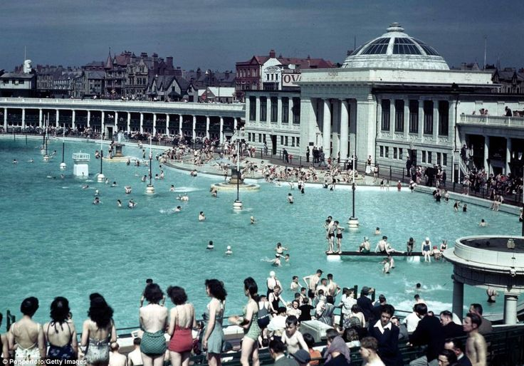 Cooling off: Crowds of people cooling off in a swimming pool on a hot day in Blackpool in July 1944