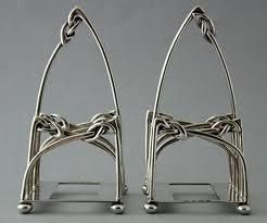 Archibald Knox, a pair of toast racks.